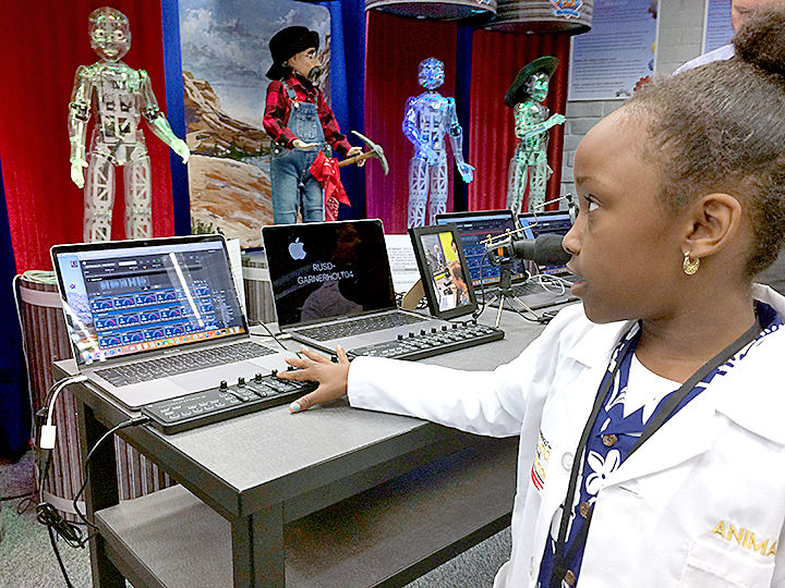 Girl working with animatronics