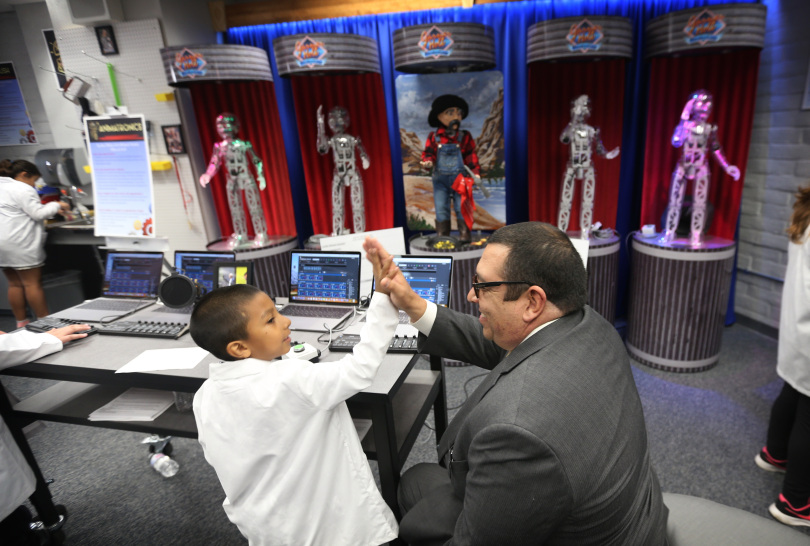 Redlands Unified School Board member and student after animatronics display in Garner Holt Education Through Imagination Animakerspace