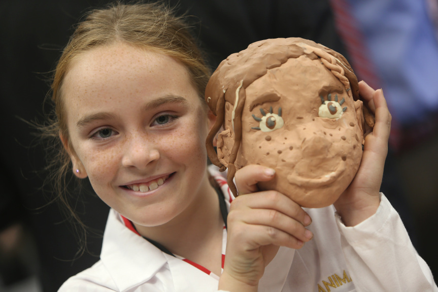 Student with clay model of herself in Garner Holt Education Through Imagination Animakerspace