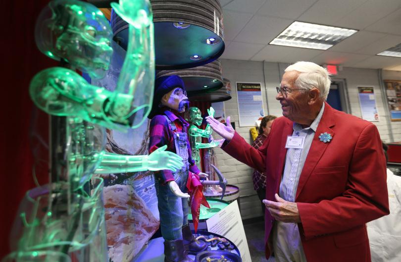 Disney Imagineer Bob Gurr interacting with animatronics in Garner Holt Education Through Imagination Animakerspace